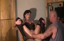 Bald tattooed man fisting his dirty wife