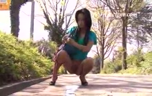 Teen peeing in the park