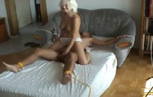 Bizarre ball busting fuck on the bed