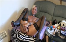 Mature blonde stretches ass with black dildo