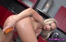 Blonde plowing her wet pussy in the kitchen