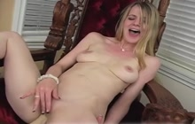 Cute blonde gets satisfied on the chair